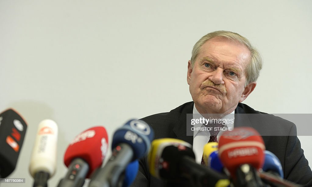 Karl Huber, President of the Higher Regional Court Munich (Oberlandesgerichtes Muenchen), reacts during a press conference on April 29, 2013 in Munich, southern Germany, following the lottery for the reserved press seats for the trial against the sole survivor of the far-right militants NSU and four other alleged neo-Nazi accomplices, to take place on May 6, 2013. AFP PHOTO/CHRISTOF STACHE