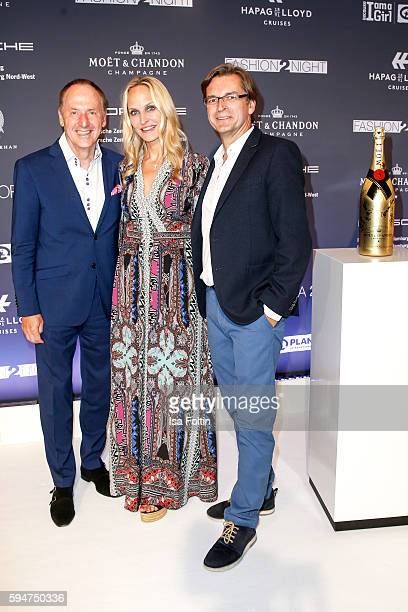 Karl J Pojer CEO HapagLloyd Cruises and Anne MeyerMinnemann chief editor Gala Germany and her husband Claus Strunz attend the Fashion2Night event at...