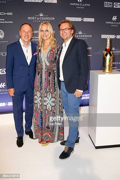 Karl J Pojer CEO HapagLloyd Cruises Anne MeyerMinnemann chief editor Gala Germany and her husband Claus Strunz attend the Fashion2Night event at...