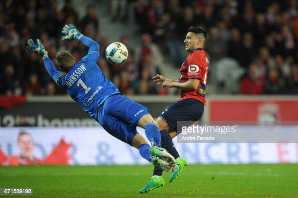 Karl Johan Johnsson of Guingamp and Rony Lopes of Lille during the Ligue 1 match between Lille OSC and EA Guingamp at Stade PierreMauroy on April 22...