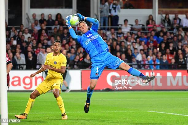Karl Johan Johnsson of Guingamp gathers the ball under pressure from Marquinhos of PSG during the Ligue 1 match between EA Guingamp and Paris Saint...