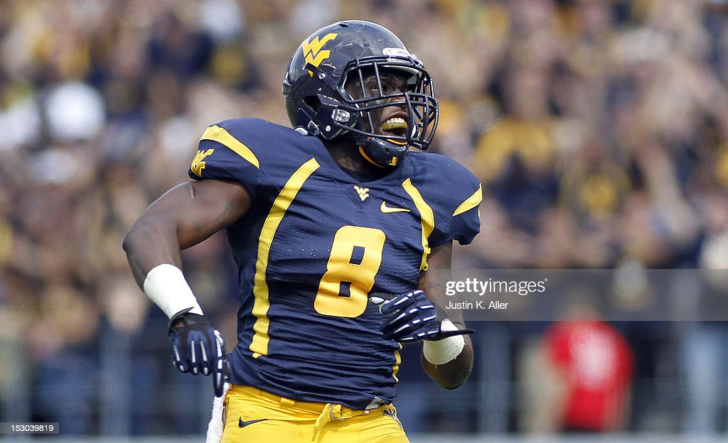 Karl Joseph of the West Virginia Mountaineers pumps up the crowd against the Baylor Bears during the game on September 29 2012 at Mountaineer Field...