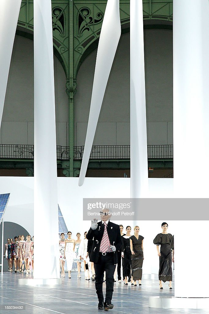 Karl Lagerfeld acknowledges the applause of the audience after the Chanel Spring / Summer 2013 show as part of Paris Fashion Week at Grand Palais on October 2, 2012 in Paris, France.