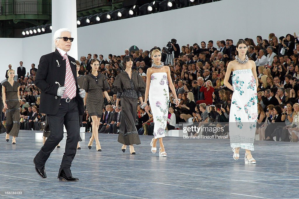 Karl Lagerfeld (L) acknowledges the applause of the audience after the Chanel Spring / Summer 2013 show as part of Paris Fashion Week at Grand Palais on October 2, 2012 in Paris, France.