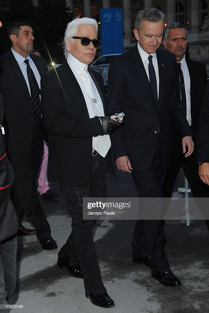 Karl Lagerfeld and Bernard Arnault arrive at 'The Glory Of Water' : Karl Lagerfeld's Exhibition Dinner at Fendi on July 3, 2013 in Paris, France.