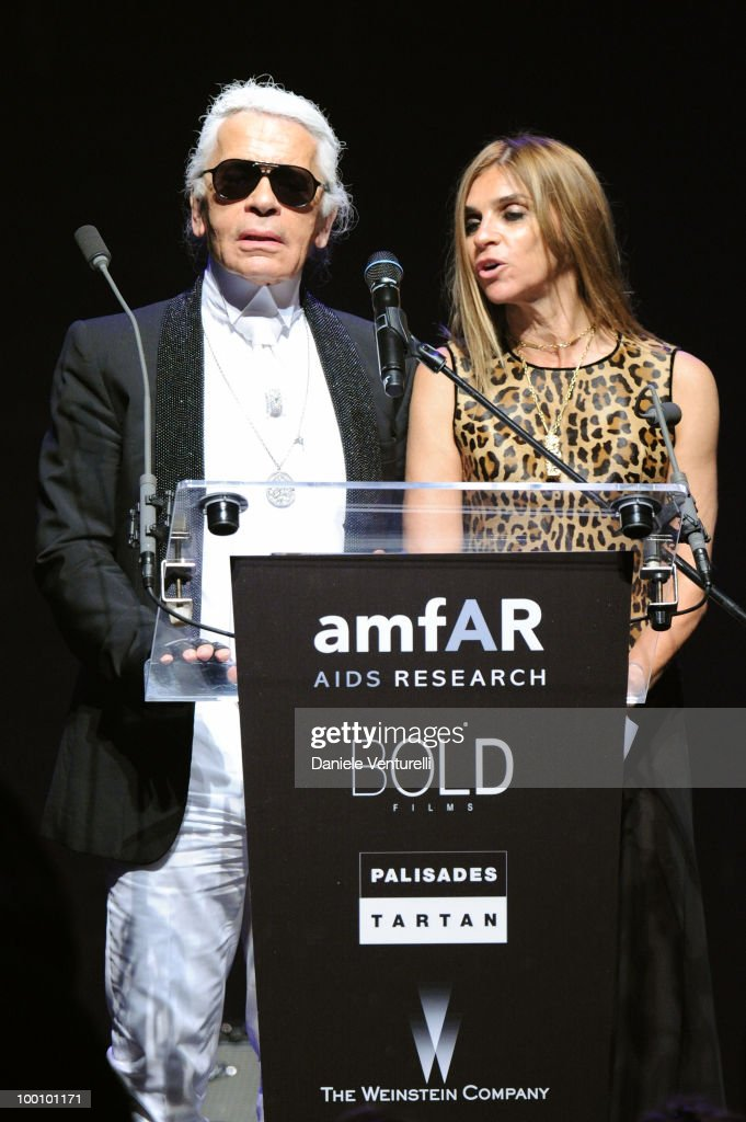 Karl Lagerfeld (L) and Carine Roitfeld speak during amfAR's Cinema Against AIDS 2010 benefit gala at the Hotel du Cap on May 20, 2010 in Antibes, France.