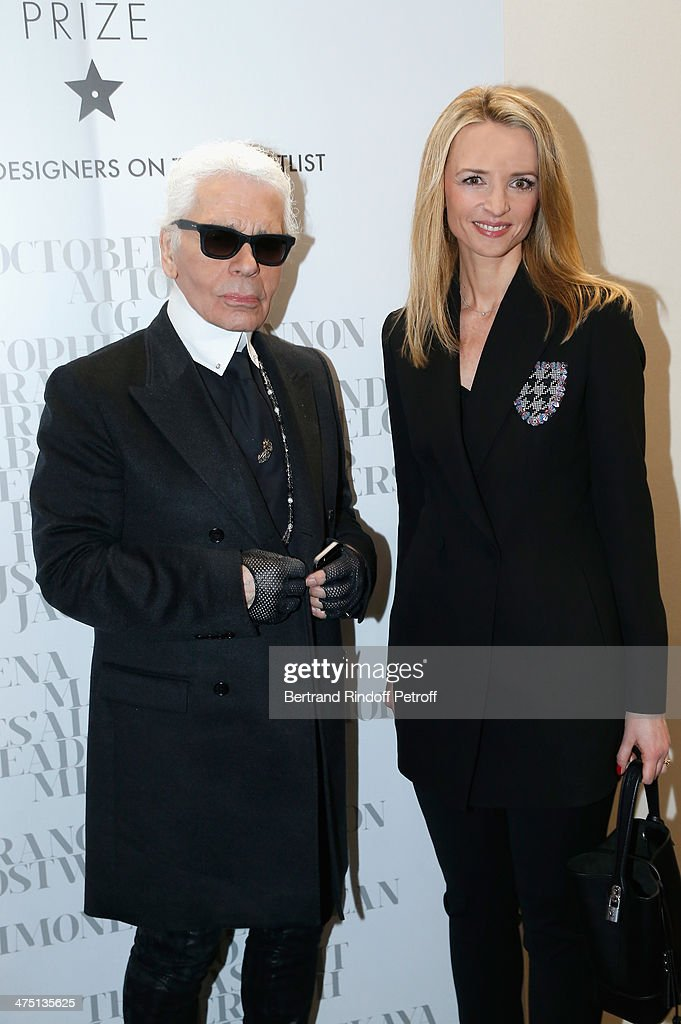 Karl Lagerfeld and Delphine Arnault attend LVMH Prize Semi-Finalists Designers Cocktail Party on February 26, 2014 in Paris, France.