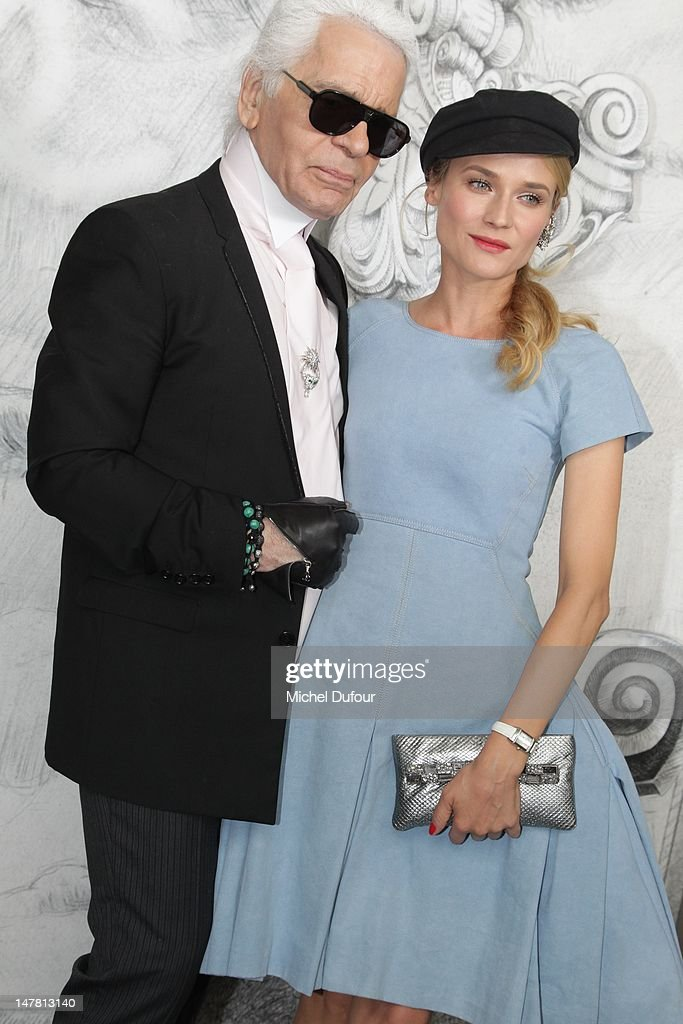 Karl Lagerfeld and <a gi-track='captionPersonalityLinkClicked' href=/galleries/search?phrase=Diane+Kruger&family=editorial&specificpeople=202640 ng-click='$event.stopPropagation()'>Diane Kruger</a> attend the Chanel Haute-Couture Show as part of Paris Fashion Week Fall / Winter 2013 at Grand Palais on July 3, 2012 in Paris, France.