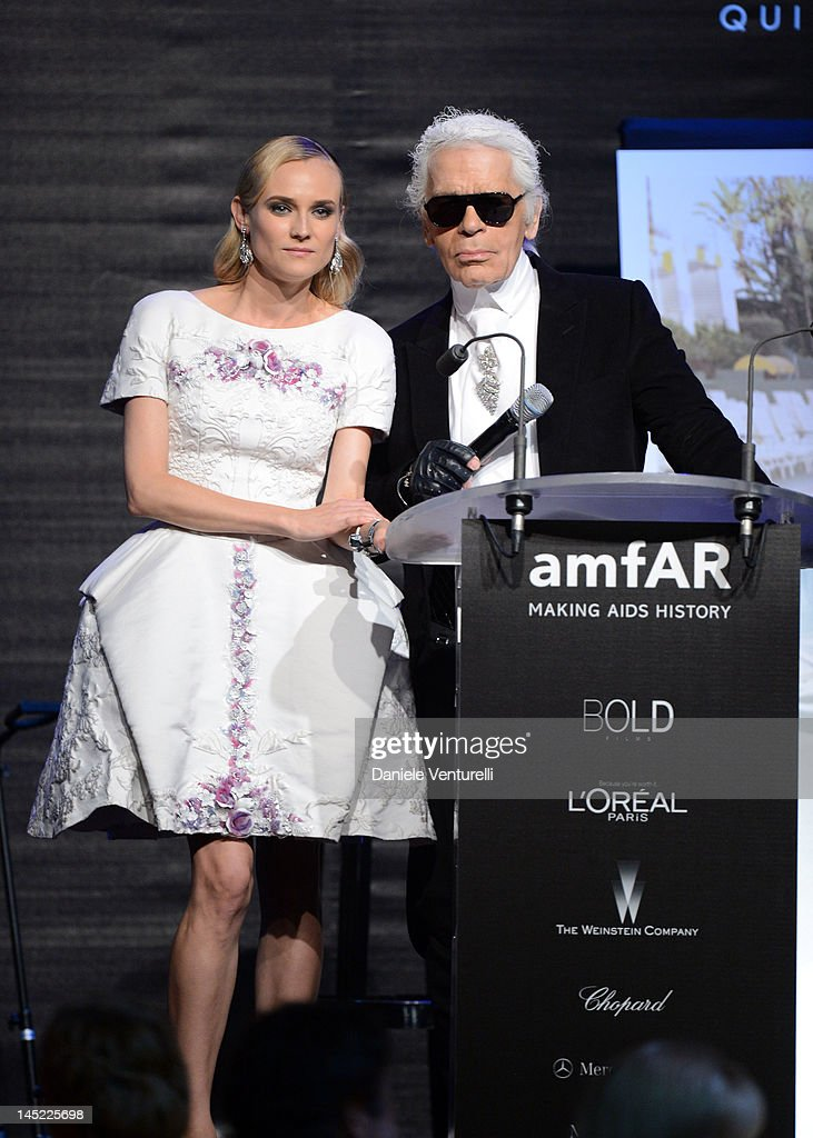 Karl Lagerfeld and <a gi-track='captionPersonalityLinkClicked' href=/galleries/search?phrase=Diane+Kruger&family=editorial&specificpeople=202640 ng-click='$event.stopPropagation()'>Diane Kruger</a> speak at the 2012 amfAR's Cinema Against AIDS during the 65th Annual Cannes Film Festival at Hotel Du Cap on May 24, 2012 in Cap D'Antibes, France.