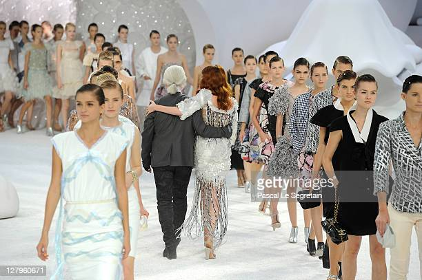 Karl Lagerfeld and Florence Welch of Florence and the Machine walk the runway with models during the Chanel Ready to Wear Spring / Summer 2012 show...