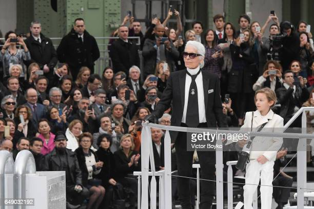 Karl Lagerfeld and Hudson Kroenig walk the runway during the finale of the Chanel show as part of the Paris Fashion Week Womenswear Fall/Winter...
