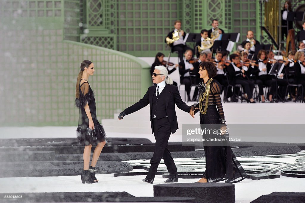 Karl Lagerfeld and Ines De La Fressange on the runway at the Chanel show as part of Paris Fashion Week Spring/Summer 2011 at the 'Grand Palais' in Paris.