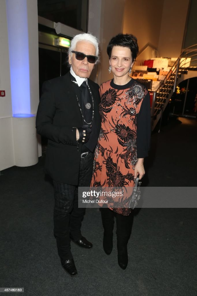 <a gi-track='captionPersonalityLinkClicked' href=/galleries/search?phrase=Karl+Lagerfeld+-+Fashion+Designer&family=editorial&specificpeople=4330565 ng-click='$event.stopPropagation()'>Karl Lagerfeld</a> and <a gi-track='captionPersonalityLinkClicked' href=/galleries/search?phrase=Juliette+Binoche&family=editorial&specificpeople=209273 ng-click='$event.stopPropagation()'>Juliette Binoche</a> attend the Annual Charity Dinner Hosted By The AEM Association Children Of The World For Rwanda on December 17, 2013 in Paris, France.
