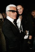 Karl Lagerfeld and L'wren Scott chat backstage at the Chanel fashion show as part of Paris Fashion Week Spring/Summer 2005 on January 25 2005 in...