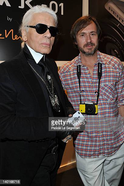 Karl Lagerfeld and Marc Newson attend the Marc Newson Pentax The Unveiling Of 'K01' Champagne Cocktail at Colette during Paris Fashion Week on...