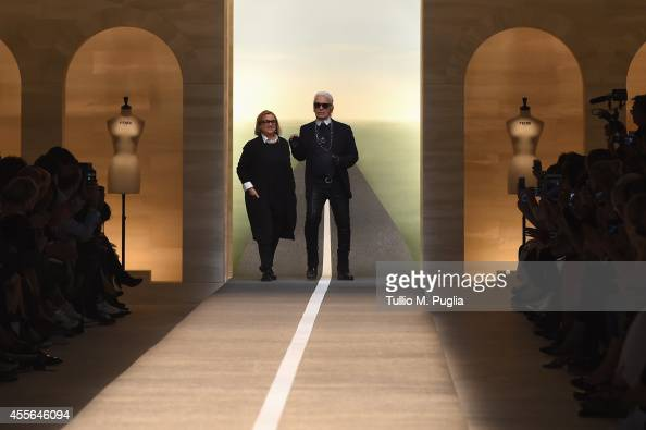 Karl Lagerfeld and Silvia Venturini Fendi acknowledge the applause of the audience after the Fend show as a part of Milan Fashion Week Womenswear...