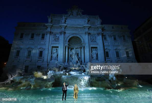 Karl Lagerfeld and Silvia Venturini Fendi acknowledge the applause of the public after the Fendi Roma 90 Years Anniversary fashion show at Fontana di...