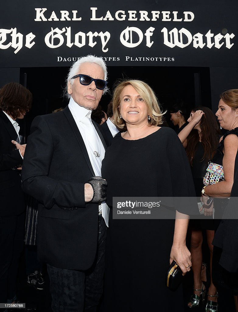 Karl Lagerfeld and Silvia Venturini Fendi attend 'The Glory Of Water' Karl Lagerfeld's Exhibition Preview on July 3, 2013 in Paris, France.