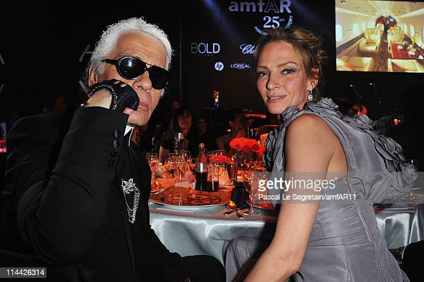 Karl Lagerfeld and Uma Thurman attend amfAR's Cinema Against AIDS Gala during the 64th Annual Cannes Film Festival at Hotel Du Cap on May 19 2011 in...