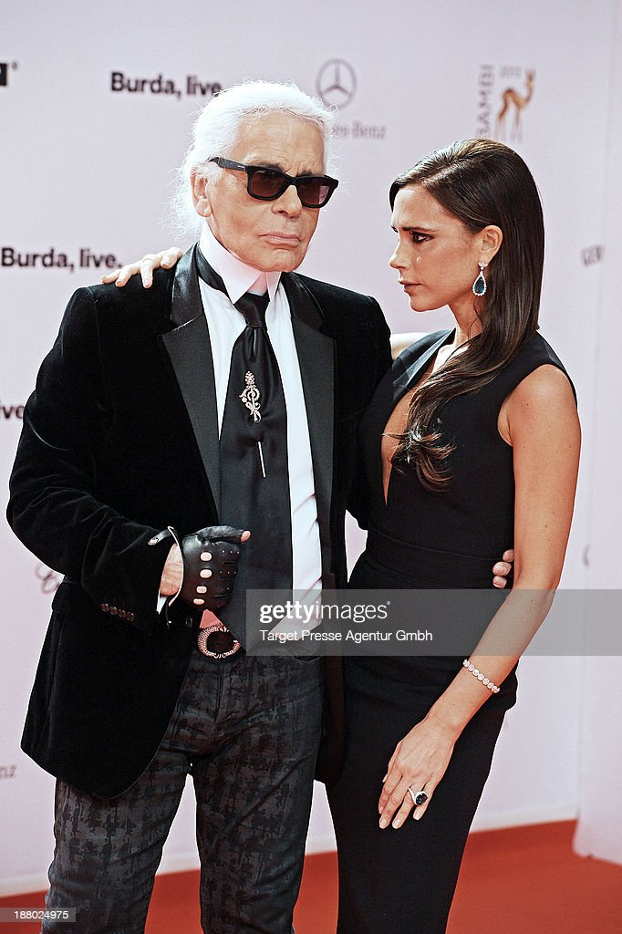Karl Lagerfeld and Victoria Beckham pose with the Bambi for best fashion at the Bambi Awards at Stage Theater on November 14, 2013 in Berlin, Germany.