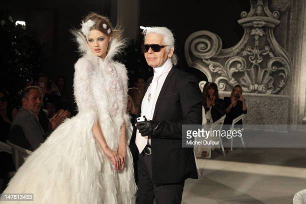 Karl Lagerfeld and wedding dress model walk the runway during the Chanel HauteCouture Show as part of Paris Fashion Week Fall/Winter 2012/13 at Grand...