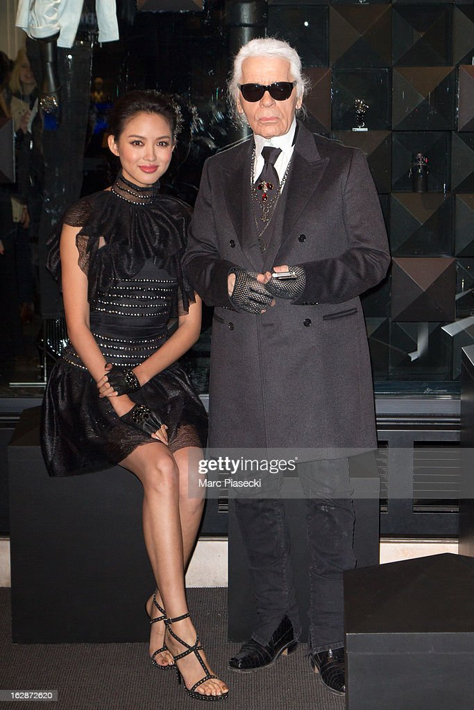 Karl Lagerfeld (R) and Zhang Zilin attend the Karl Lagerfeld's Concept Store Opening as part of Paris Fashion Week on February 28, 2013 in Paris, France.