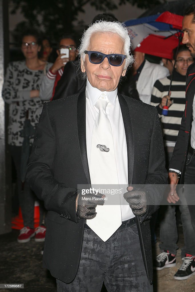 Karl Lagerfeld arrives to attend the 'The Glory of Water' Karl Lagerfeld's exhibition at FENDI store on Avenue Montaigne on July 3, 2013 in Paris, France.
