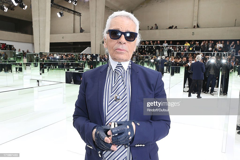 <a gi-track='captionPersonalityLinkClicked' href=/galleries/search?phrase=Karl+Lagerfeld+-+Fashion+Designer&family=editorial&specificpeople=4330565 ng-click='$event.stopPropagation()'>Karl Lagerfeld</a> attends Dior Homme Menswear Spring/Summer 2014 show as part of Paris Fashion Week on June 29, 2013 in Paris, France.