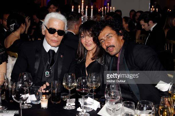 Karl Lagerfeld Babeth Djian and Haider Ackermann attend the Babeth Djian Charity Dinner for AEM Rwanda at Espace Cardin on November 21 2010 in Paris...