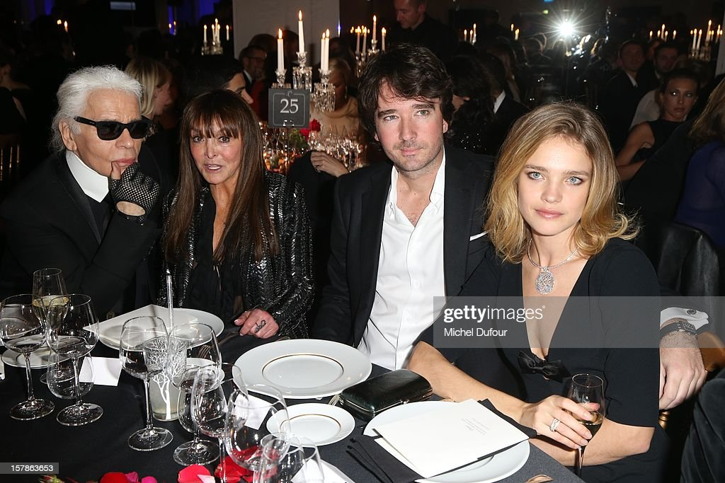 Karl lagerfeld, Babeth Djian, Antoine Arnault and Natalia Vodianova attend the Babeth Djian Hosts Dinner For Rwanda To The Benefit Of A.E.M. on December 6, 2012 in Paris, France.