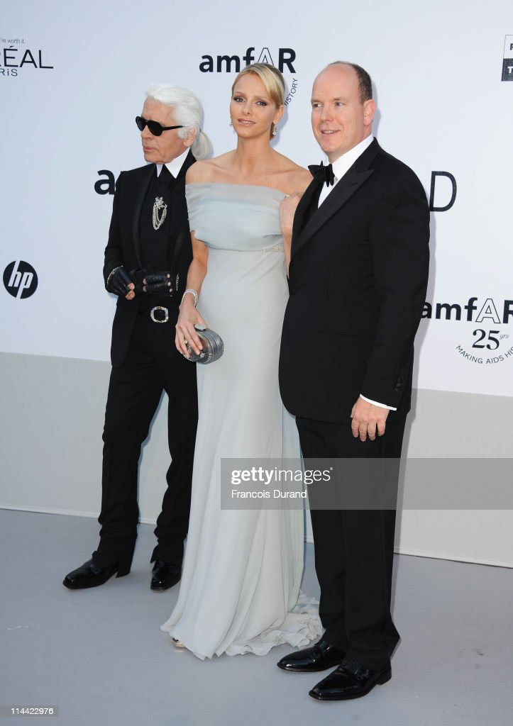 Karl Lagerfeld, Charlene Wittstock and Prince Albert of Monaco attend amfAR's Cinema Against AIDS Gala during the 64th Annual Cannes Film Festival at Hotel Du Cap on May 19, 2011 in Antibes, France.