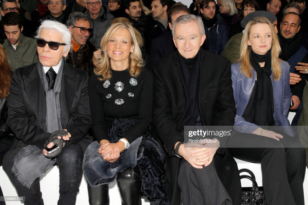 Karl Lagerfeld, <a gi-track='captionPersonalityLinkClicked' href=/galleries/search?phrase=Helene+Arnault&family=editorial&specificpeople=718530 ng-click='$event.stopPropagation()'>Helene Arnault</a>, <a gi-track='captionPersonalityLinkClicked' href=/galleries/search?phrase=Bernard+Arnault&family=editorial&specificpeople=214118 ng-click='$event.stopPropagation()'>Bernard Arnault</a>, Chairman and CEO of LVMH Moet Hennessy - Louis Vuitton, and <a gi-track='captionPersonalityLinkClicked' href=/galleries/search?phrase=Delphine+Arnault&family=editorial&specificpeople=577890 ng-click='$event.stopPropagation()'>Delphine Arnault</a> attend the Dior Homme Men Autumn/Winter 2013 show as part of Paris Fashion Week, at Quartier des Celestins, on January 19, 2013 in Paris, France.