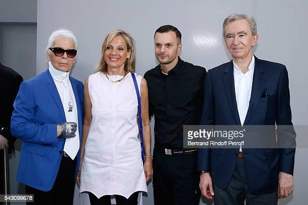 Karl Lagerfeld Helene Arnault Fashion designer Kris Van Assche and Owner of LVMH Luxury Group Bernard Arnault pose Backstage after the Dior Homme...