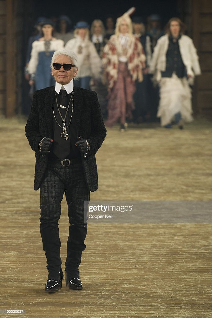 Karl Lagerfeld walks the runway after the Chanel 'Metiers d'Art' Show at Fair Park on December 10, 2013 in Dallas, Texas.