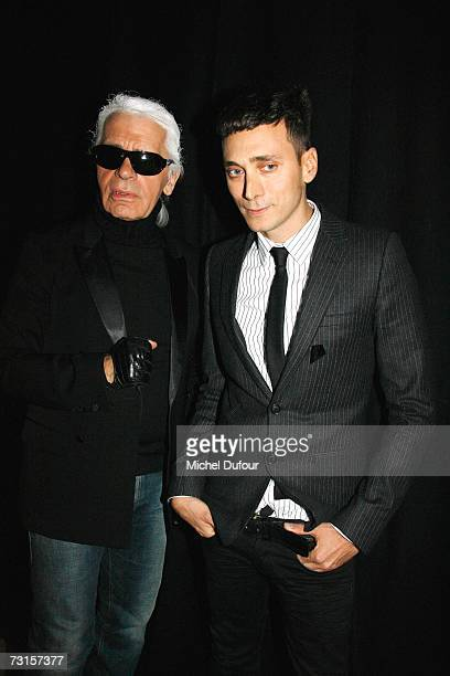 Karl Lagerfeld with Heidi Slimane attends the Dior Men Fashion Show Autumn Winter 07 08 on January 30 2007 in Paris France