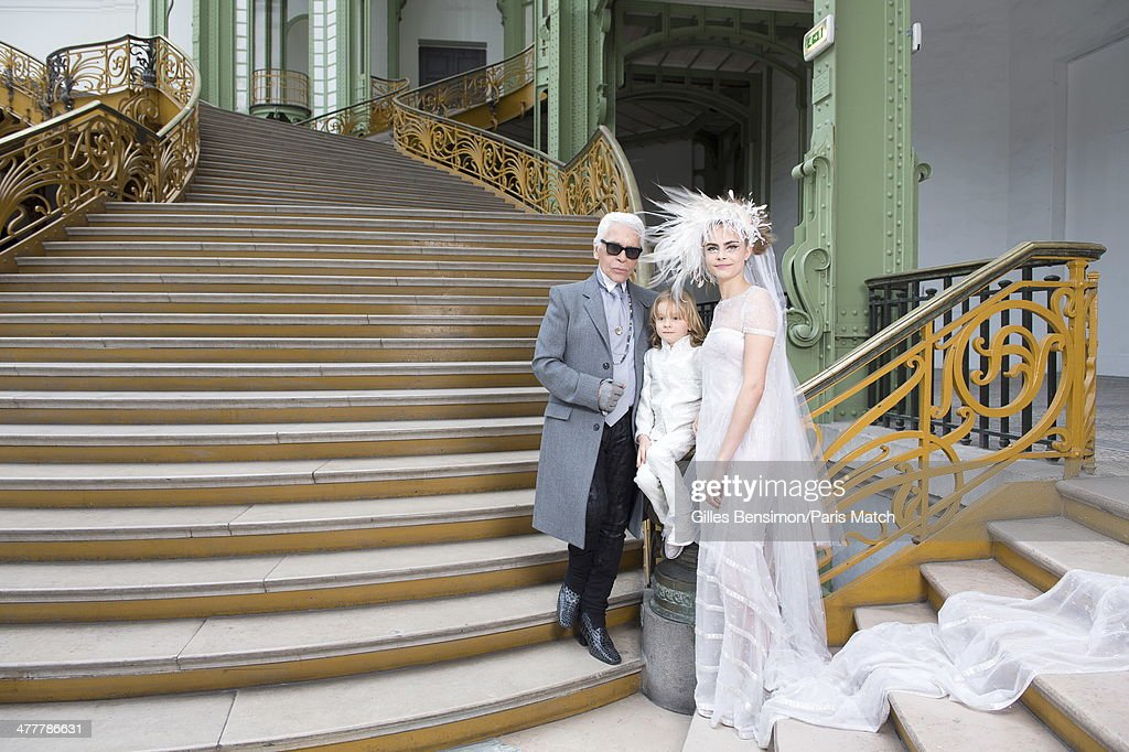 <a gi-track='captionPersonalityLinkClicked' href=/galleries/search?phrase=Karl+Lagerfeld+-+Fashion+Designer&family=editorial&specificpeople=4330565 ng-click='$event.stopPropagation()'>Karl Lagerfeld</a> with his godson Hudson and <a gi-track='captionPersonalityLinkClicked' href=/galleries/search?phrase=Cara+Delevingne&family=editorial&specificpeople=5488432 ng-click='$event.stopPropagation()'>Cara Delevingne</a> are photographed for Paris Match on January 21, 2014 in Paris, France.