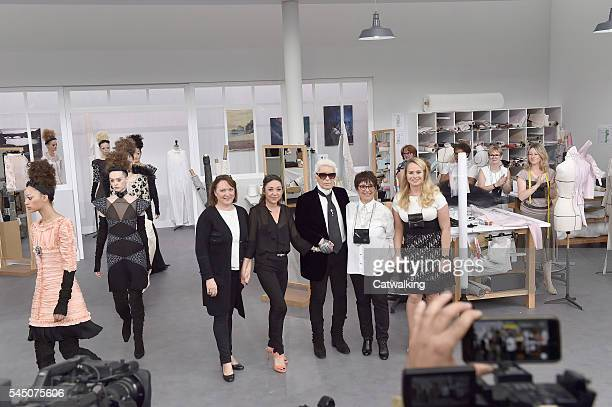 Karl Lagerfeld with members of the Chanel atelier's creative team walk the runway at the Chanel Autumn Winter 2016 fashion show during Paris Haute...