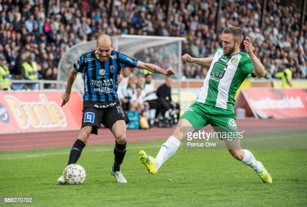 Karl Larson of IK Sirius FK and Mats Solheim of Hammarby IF during the Allsvenskan match between IK Sirius FK and Hammarby IF at Studenternas IP on...
