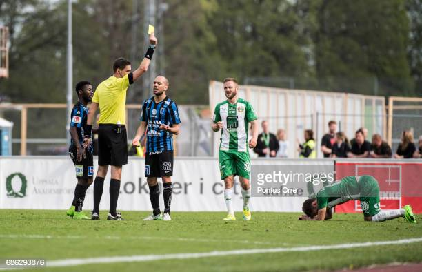 Karl Larson of IK Sirius FK gets a yellow card during the Allsvenskan match between IK Sirius FK and Hammarby IF at Studenternas IP on May 21 2017 in...