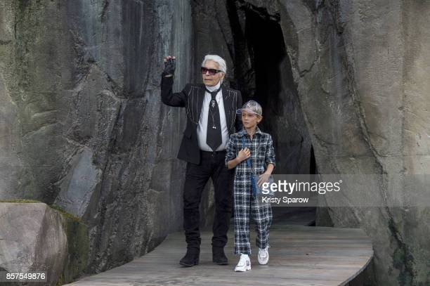 Karl Legerfeld acknowledges the audience with Hudson Kroening during the Chanel show as part of Paris Fashion Week Womenswear Spring/Summer 2018 on...