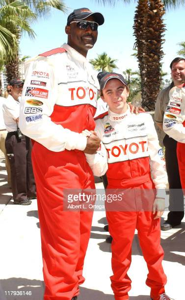 Karl Malone and Frankie Muniz during 29th Annual Toyota Pro/Celebrity Race at The Long Beach Convention Center in Long Beach California United States