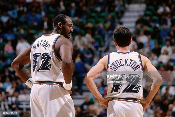 Karl Malone and John Stockton of the Utah Jazz chats against the Vancouver Grizzlies on November 15 1996 at the Delta Center in Salt Lake City Utah...