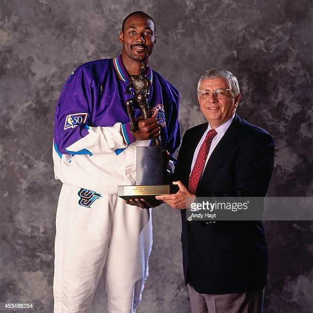 Karl Malone of the Utah Jazz and NBA Commissioner David Stern poses for a portrait circa May 1997 with the MVP trophy in Salt Lake City Utah NOTE TO...