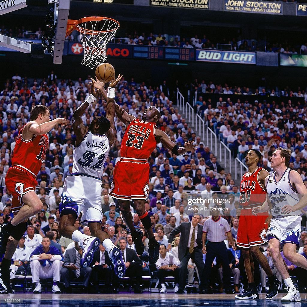 Karl Malone #32 of the Utah Jazz attempts a layup against Michael Jordan #23 of the Chicago Bulls in Game Six of the 1998 NBA Finals at the Delta Center on June 14, 1998 in Salt Lake City, Utah. The Bulls defeated the Jazz 87-86.