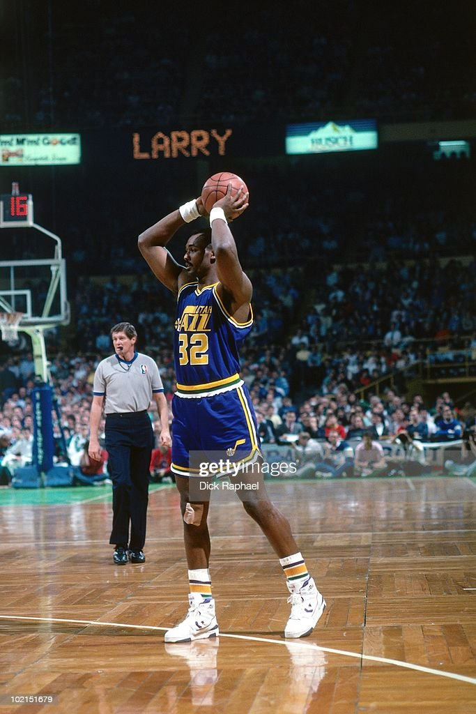 Karl Malone #32 of the Utah Jazz passes against the Boston Celtics during a game played in 1990 at the Boston Garden in Boston, Massachusetts.