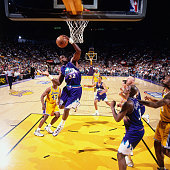 Karl Malone of the Utah Jazz rebounds against the Los Angeles Lakers in Game Four of the Western Conference Semifinals as part of the 1998 NBA...