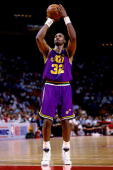 Karl Malone of the Utah Jazz shoots a free throw in game five of the Western Conference Finals against the Utah Jazz during the 1994 NBA Playoffs at...