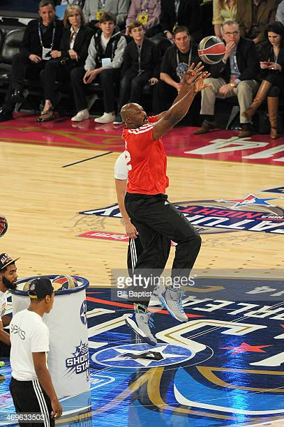 Karl Malone of the West Team shoots during the Sears Shooting Stars Competition on State Farm AllStar Saturday Night as part of the 2014 AllStar...