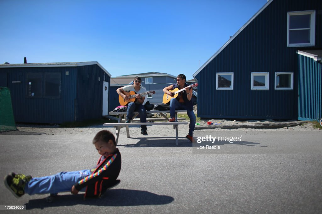 Karl Peter Jakobsen (L) and Miki Lange practice with their guitars as they enjoy a warm summer day on July 29, 2013 in Nuuk, Greenland. Nuuk, the capital of the country of about 56,000 people, is where the government is trying to balance the discovery of minerals and other new opportunities brought on by climate change with the old ways of doing things. Premier Aleqa Hammond, the leader of Greenlands Parliament, said: 'Climate change is one of the major issues that were dealing with in the political Greenland, in the cultural Greenland and in the business sector of Greenland. Climate change is not only a bad thing for Greenland. Climate change has resulted in many other new options for Greenland.
