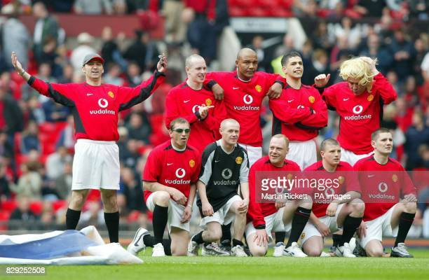 Karl Power with a team of imposters invade the pitch to form a Manchester United lookalike team lineup before the kickoff in the FA Barclaycard...